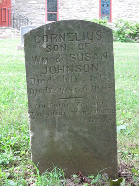 1863 gravestone of Cornelius Johnson, probably a slave, in the St. Mark's churchyard.