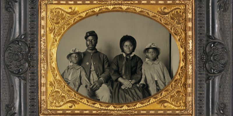 Photograph of black ancestors: an unidentified African-American Civil War soldier with his wife and two daughters.